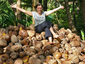 lady sitting on coconuts