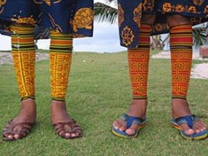 feet of children in colourful clothes