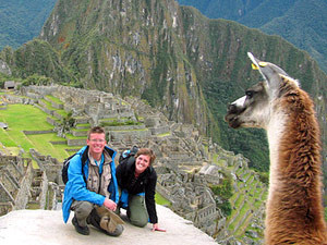 Couple being photobombed by a llama in Machu Picchu