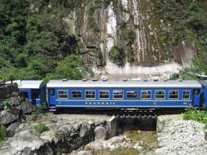 Blue train going through the mountains