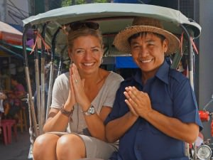 Female traveller with a local thai man