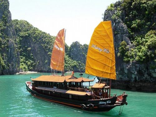 Chinese junk boat floating in Halong Bay Vietnam