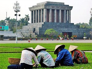 Locals on grass in Hanoi