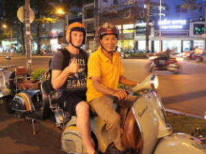 man riding a vespa in vietnam
