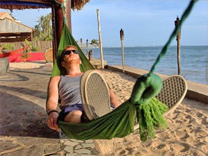 Man lying asleep in a hammock in Nha Trang Vietnam