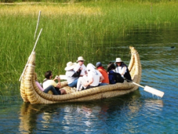 Bolivia customers riding reed boat on river
