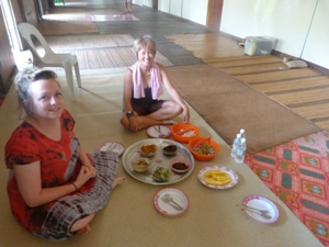 staff member eating with Iban tribe in borneo