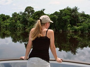 girl looking out of boat in amazon