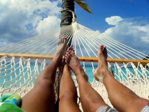 People swinging in a hammock in Brazil