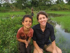 Woman smiling with local child in Cambodian village