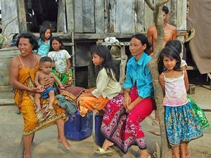 Family sitting in front of their house in Battambang Cambodia