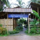 Entrance of the accommodation with blue sign