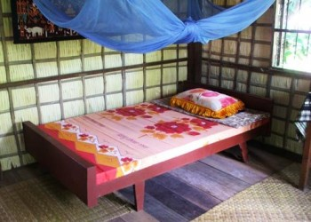 single bed with colourful sheets