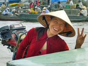 Local woman with hat smiling