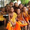 A group of smiling children monks, wearing traditional monk robes in Phnom Penh in Cambodia