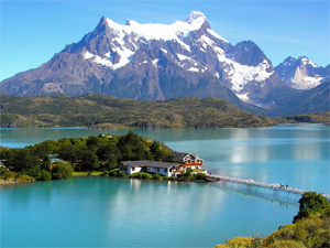 View over Torres with aqua green water and snow capped mountains behind
