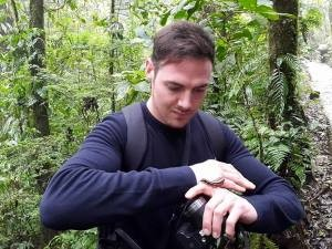 man holding centipede in Costa Rica national park