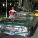 woman in front of Cadillac, Cuba