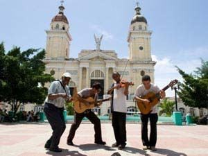 Street musicians playing live music in the streets of Santiago in Cuba