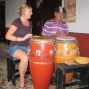 Woman playing drums in Cuba