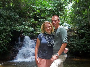 Couple in front of a waterfall, Malaysia