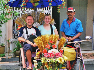 Malaysia customers riding in Rickshaw