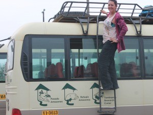 Woman standing by a bus