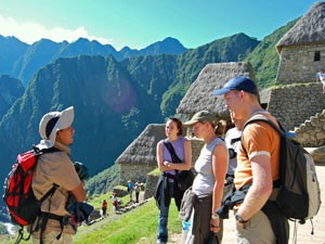 Guide and group along the Inca Trail, Peru