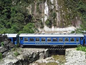 Train by mountain scenery