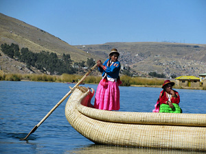 Peru Lake Titicaca two local woman in boat in traditional clothing