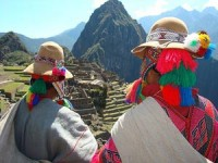 Local people in colourful clothes overlooking Machu Picchu in Peru