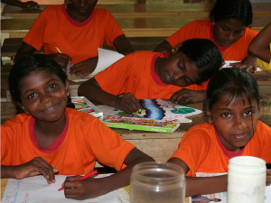 two girls smiling while learning