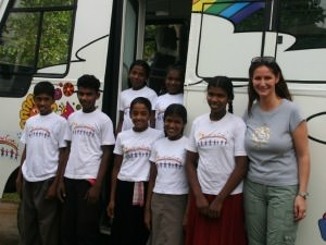 group of children standing outside school bus
