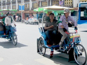 Local cycling Rickshaw in Lhasa in Tibet