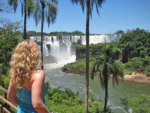 Woman looking at Iguazu Falls