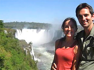Customer in front of the waterfall