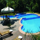 Argentina hotel swimming pool outside with lounge chairs and umbrellas