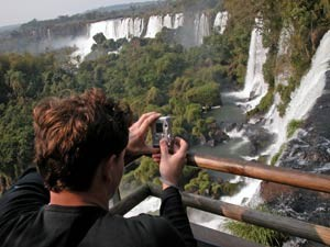Customer taking a picture of the waterfall