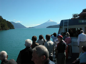 Customers on the boat looking at the mountains