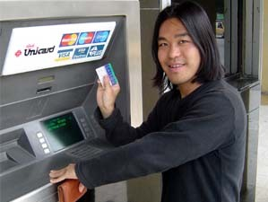 Customer withdrawing cash from an ATM