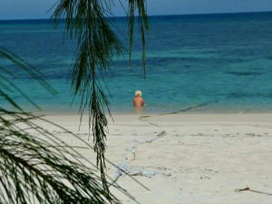 customer sitting in turquiose sea in borneo