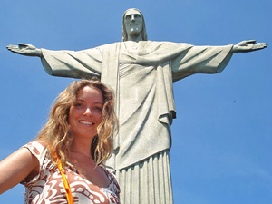 woman smiling in fornt of christ the redeemer statue