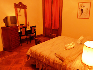 Argentina hotel room bed and desk with chairs
