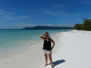 Travel Specialist Emma standing on a beach