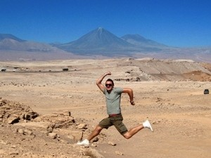 man jumping in the desert of chile