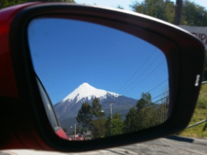 Reflection of mountain in car mirror