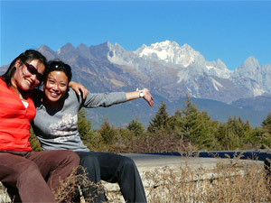 Couple posing in front of mountains