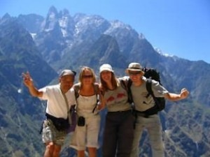 Group of travellers trekking by mountains at Tiger Leaping Gorge in China
