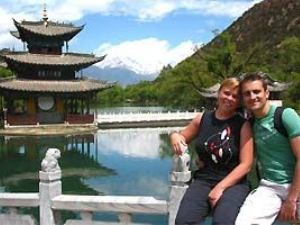 Couple sitting by temple