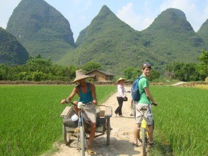 Customer cycling through the mountainous countryside in China
